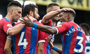 Luka Milivojevic is congratulated by his Crystal Palace teammates after scoring against Norwich.