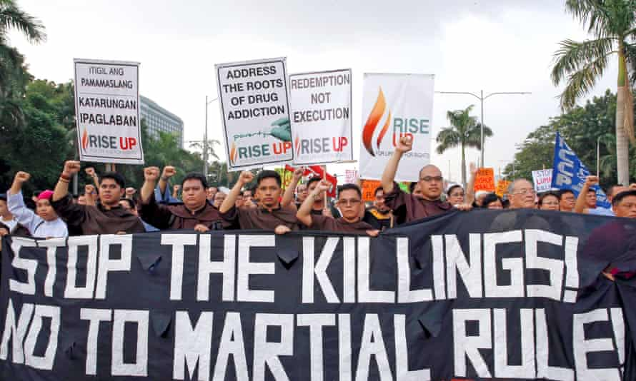Protesters stage a protest rally against extrajudicial killings.