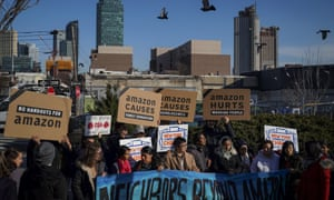 Activists and community members rally against Amazon's plan to move into Queens