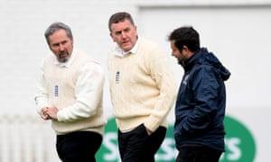 Umpires Richard Illingworth and Rob Bailey talk to Somerset head groundsman Simon Lee.