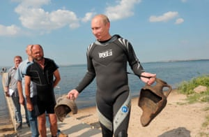 August 2011: Putin carries artefacts he personally recovered while diving at an archaeological site off the Taman peninsular