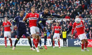 Derby's Jayden Bogle watches his attempted clearance head towards the net as Middlesbrough's Rudy Gestede begins to hope