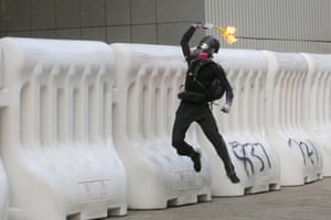 A molotov cocktail is thrown