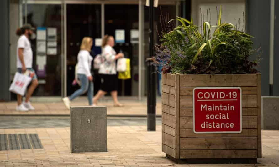 A notice advises members of the public to maintain a social distance in the city centre of Preston