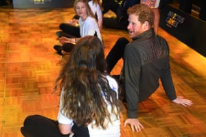 Prince Harry chats with Taleah Till, 16, from Woronora as he sits with schoolchildren after watching demonstration sports