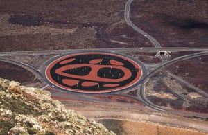 Lanzarote, Canary Islands. The view from Montana de la Cinta of an artwork in a roundabout