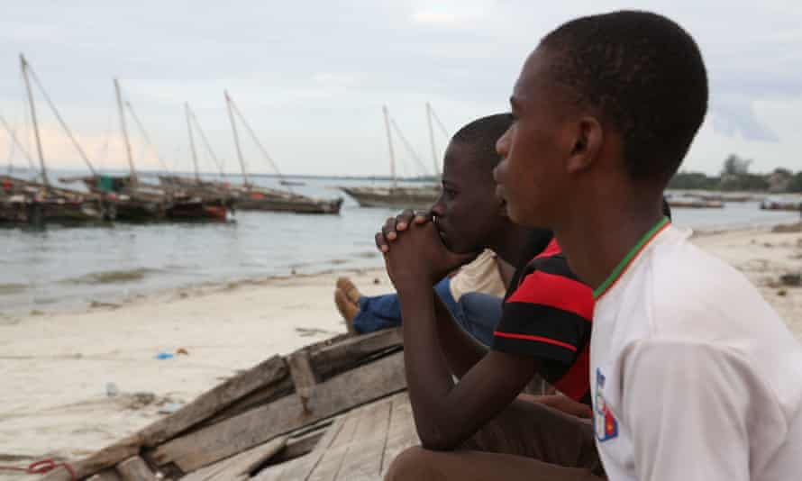 Young men look out to sea at the town of Bagamoyo, Tanzania. A culture of speaking out has grown among younger Tanzanians, but new media laws could make the country one of the continent's worst for freedom of expression.