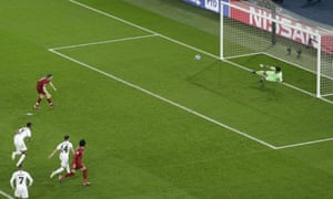 Liverpool's James Milner scores a penalty kick.