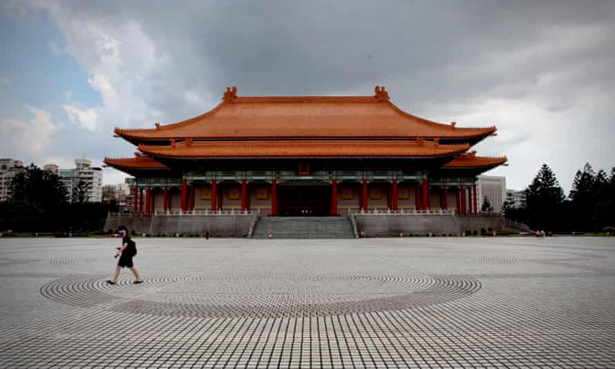Taipei's famous Chiang Kai-shek Memorial park is almost empty as authorities battle a worsening outbreak in the north of Taiwan.