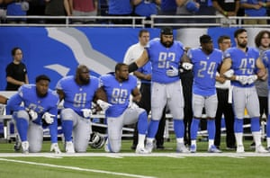 Detroit Lions players Armonty Bryant, A'Shawn Robinson and Cornelius Washington take a knee during the national anthem before an NFL football game against the Atlanta Falcons.