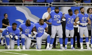 Members of the Detroit Lions kneel and stand during the national anthem last season
