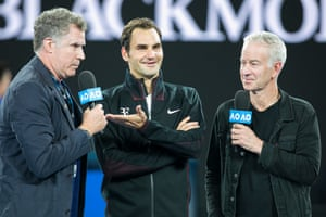 Roger Federer chats with American actor and comedian Will Ferrell and ex-player John McEnroe after his straight-sets victory.