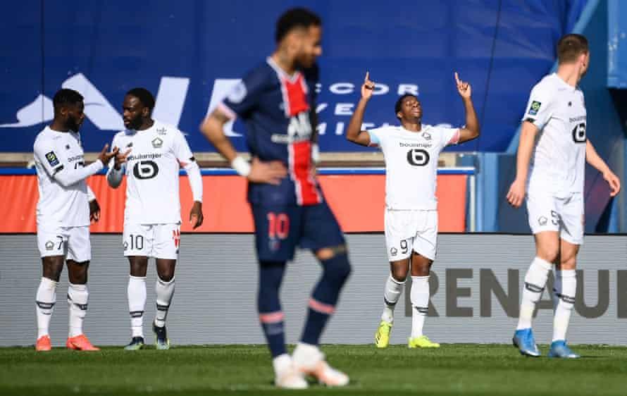 Jonathan David celebrates after scoring the winner for Lille against PSG.