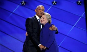 Democratic presidential nominee Clinton hugs US President Obama as she arrives onstage at the end of his speech on the third night of the 2016 Democratic National Convention in Philadelphia.
