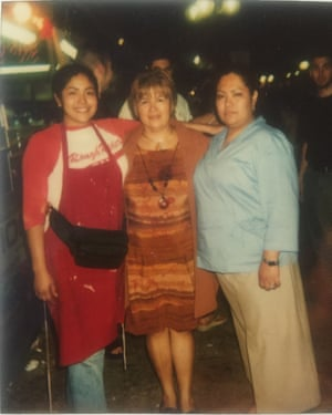 Julissa Arce in 2001 with her mother and sister in front of their funnel cake cart in San Antonio