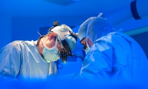 Surgeons performing open heart surgery in modern operation room.