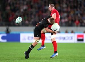 Alun Wyn Jones is tackled by Sam Cane