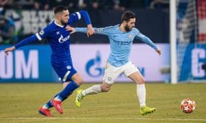 Bernardo Silva holds off Nabil Bentaleb during Manchester City's Champions League win over Schalke.