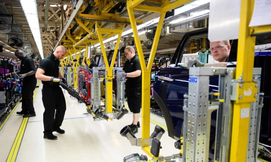 Technicians work on the Mini assembly line