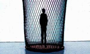 Silhouette of man standing in wastepaper baske