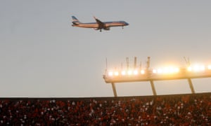 A plane flies over the Monumental stadium in Buenos Aires during a league match between River Plate and Boca Juniors in 2019.
