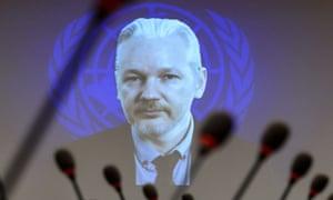 Julian Assange speaks via a webcast from the Ecuadorian embassy in London during a UN event