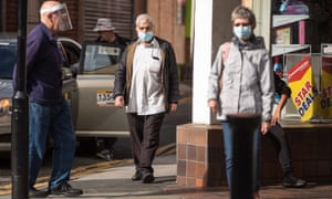 Members of the public wear masks as they walk through Bolton town centre the day the government U-turned on lockdown loosening.