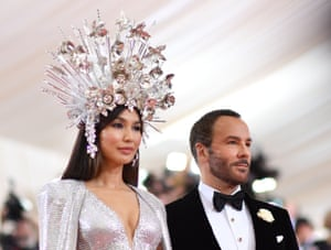 Gemma Chan with designer Tom Ford, in a dress by the designer