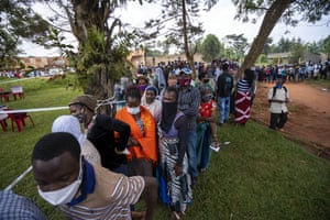 People queue to vote in a presidential election tainted by widespread violence.
