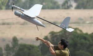 A soldier launches an Israeli army drone