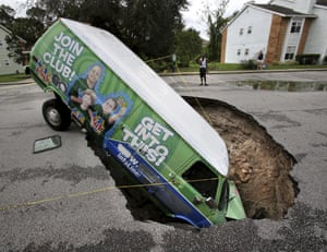 A van remains in a sinkhole