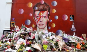 Flowers and messages left by fans in front of the David Bowie mural in Brixton
