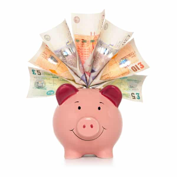 """Rich Piggy bank""""Piggy bank stuffed with all the available English sterling notes, isolated on white."""""""