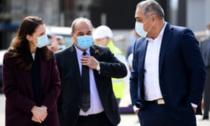 New Zealand Associate Minister of Health Hon Peeni Henare and Prime Minister Jacinda Ardern wear masks during a visit to the Kainga Ora housing development on Monday in Auckland. Face coverings are now compulsory for all New Zealanders over the age of 12 on public transport or planes.