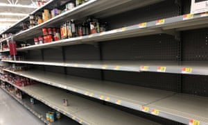 Empty shelves at Walmart in Wilmington. 'Canned meat, water, and batteries are what people are looking for right now,' said an employee.