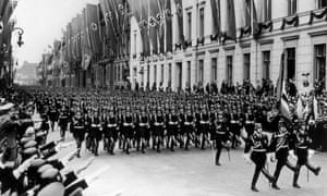 SS troops parade before Adolf Hitler in Berlin in 1939.
