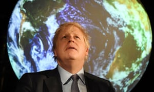 Boris Johnson in front of an image of Earth