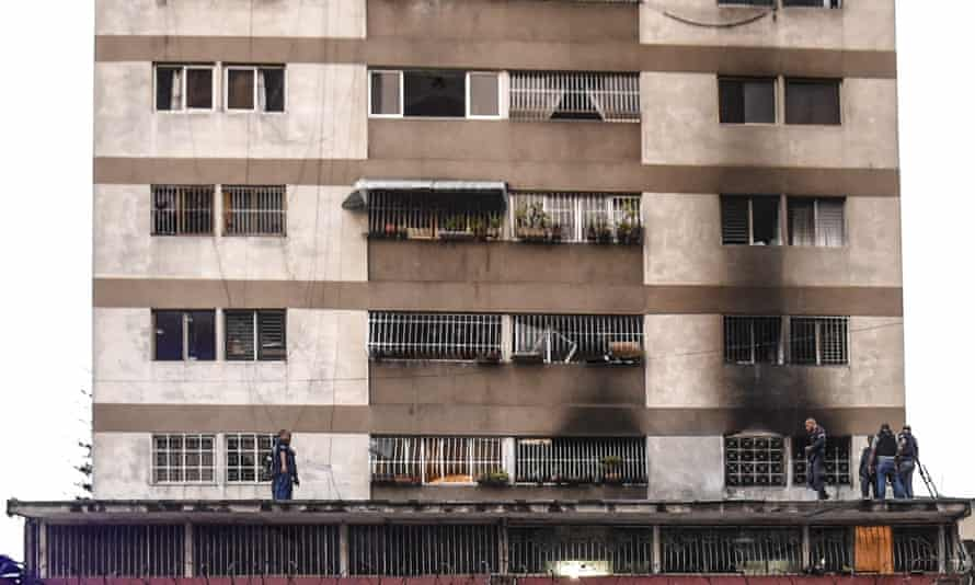 Venezuelan president survives explosive drone attackSecurity forces check a nearby building in Caracas following the explosions.