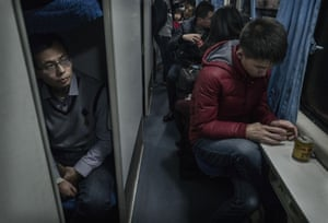 Travellers ride in a train between Beijing and Shijiazhuang. The lunar new year is the most important holiday of the year in China