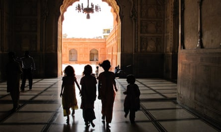 Stories from a young nation … a group of girls walks through Badshahi mosque.