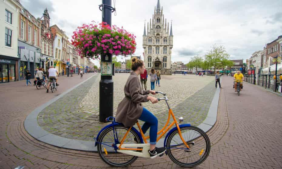 cycling in the main square of Gouda.
