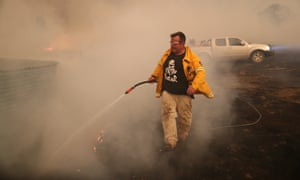 Laurence Cowie tackles a blaze near his property