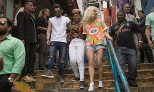 Spot the oil and gas rig? Pixie Lott, Yemi Alade & Luan Santana arrive in the Santa Marta favela in Rio de Janeiro for a concert sponsored by Shell.