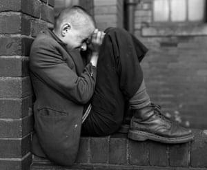 Youth on a wall, Jarrow, Tyneside, 1976