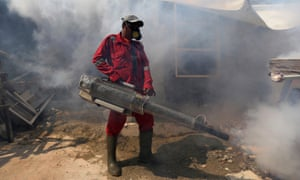 A worker sprays anti-mosquito insecticide in an attempt to control dengue fever in Jakarta.