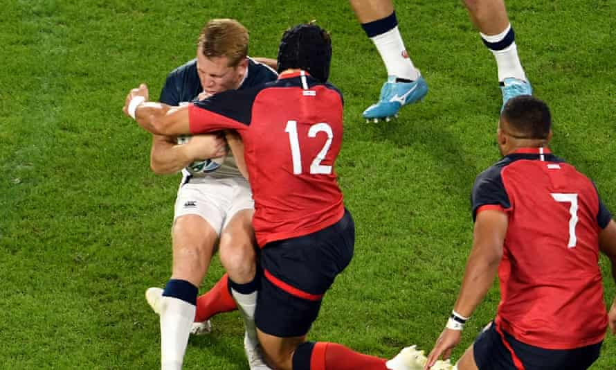 USA's Will Hooley (left) is tackled by Piers Francis of England during the Pool C game at Kobe Misaki Stadium.