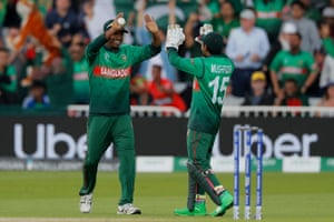 Rubel is congratulated by Mushfiqur after taking the catch to dismiss Finch for 53.