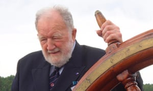 Adrian Small at the wheel of the Glasgow-built Pommern, a four-masted barque that sailed the grain route between England and Australia and is now at the Åland Maritime Museum in Mariehamn, Finland