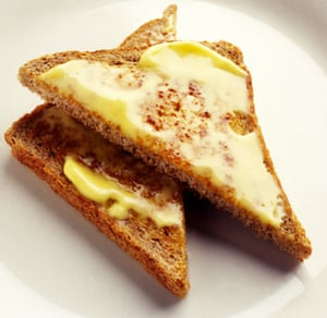 Two buttered triangles of toast