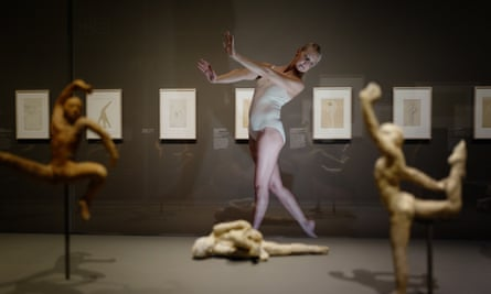 A dancer recreates one of Rodin's sculptures from Rodin and Dance: The Essence of Movement.